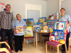 Allan with Liz, auxiliary nurse and Helen, play therapist at Edinburgh's Sick Kids oncology ward with a delivery of gifts